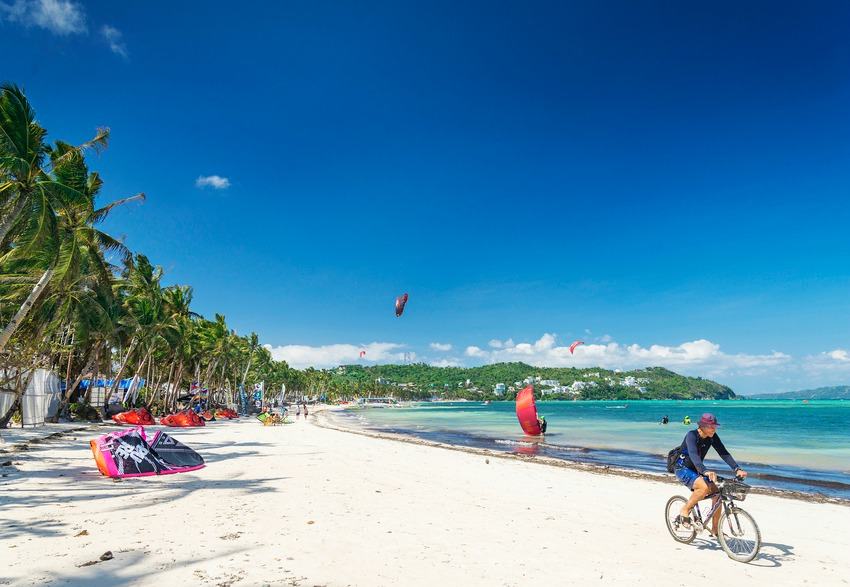 cycling and kitesurfing beach sports in boracay tropical island philippines